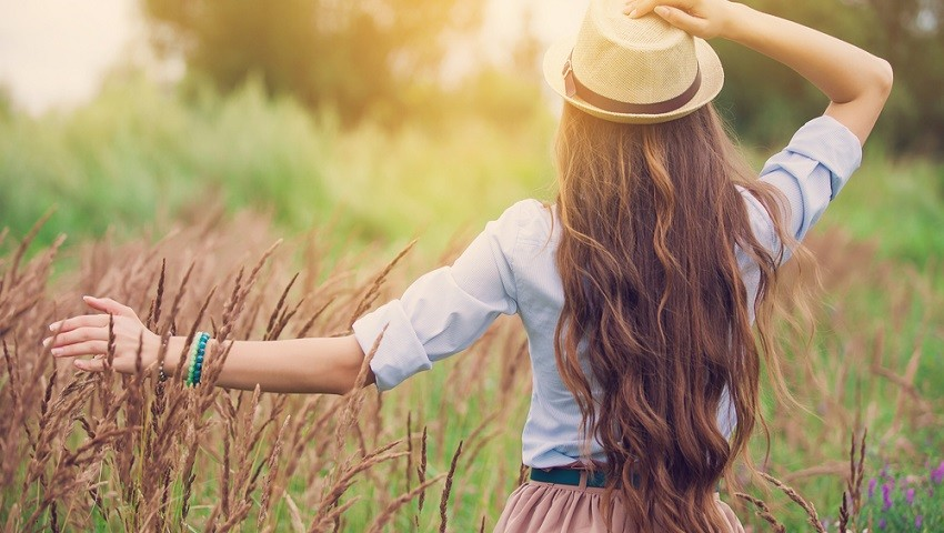 Woman With Long Hair In The Fields