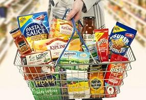 woman-holding-basket-of-processed-foods.jpg