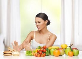 photo-of-woman-with-fruits-and-junk-food.jpg