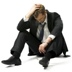 photo-of-man-sitting-on-the-floor.jpg