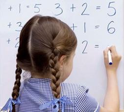 photo-of-a-child-writing-on-whiteboard.jpg