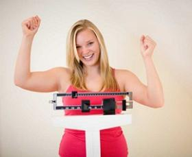 photo-of-a-happy-woman-on-weighing-scale.jpg