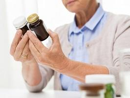 photo-of-woman-holding-bottle-supplements.jpg
