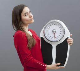 photo-of-a-woman-weighing-scale.jpg