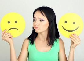 photo-of-woman-holding-different-smileys.jpg