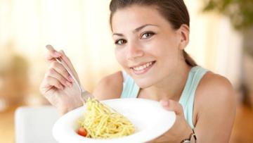 Woman with Plate of Pasta for Weight Loss