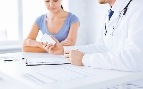 Patient and Doctor Prescribing Medicine for Hair Loss