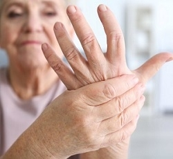 Senior Woman Holding Her Hand