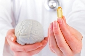 Doctor Holding Omega-3 Supplements and Brain Figure