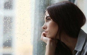 Sad Woman Looking at the Window