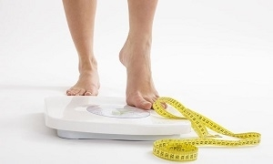 Woman on Weighing Scale