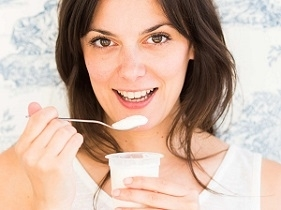 Woman Holding Cup of Yogurt for UTI
