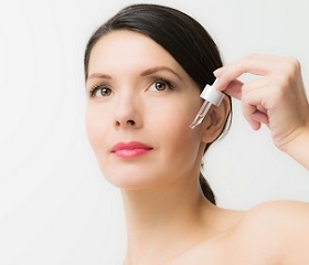 Woman Applying Serum on Face