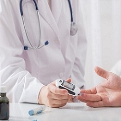 Doctor Checking Patient Blood Sugar