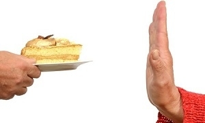 Hand Stopping Plate of Cake