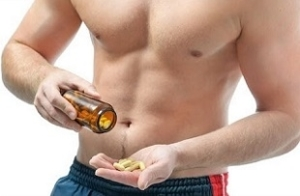 Man Holding Bottle of Supplements