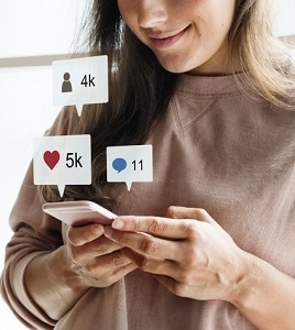 Woman using a smartphone social media concept